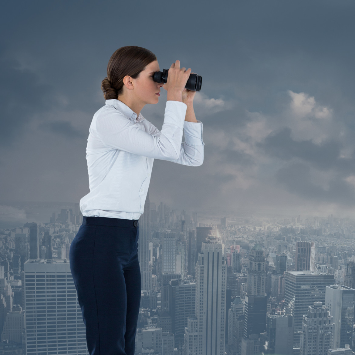 businesswoman with binoculars in cityscape