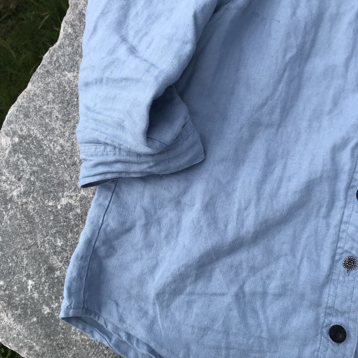 blue shirt on a rock