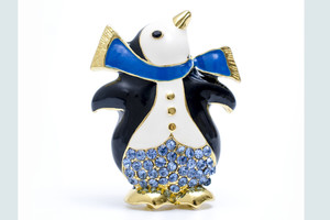 brooch penguin with diamonds isolated on white